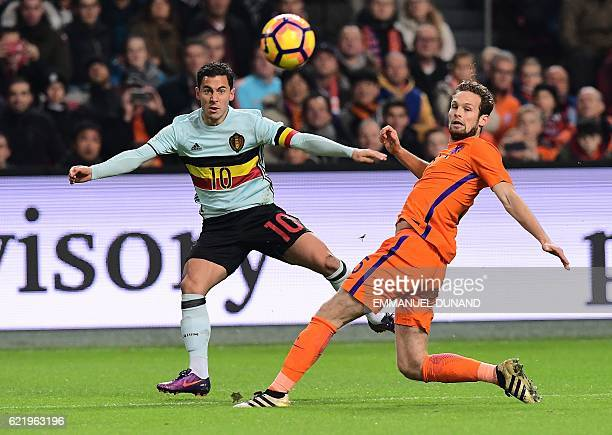 Belgium's forward Eden Hazard and Netherlands' midfielder Daley Blind eye the ball during a friendly football match between The Netherlands and...
