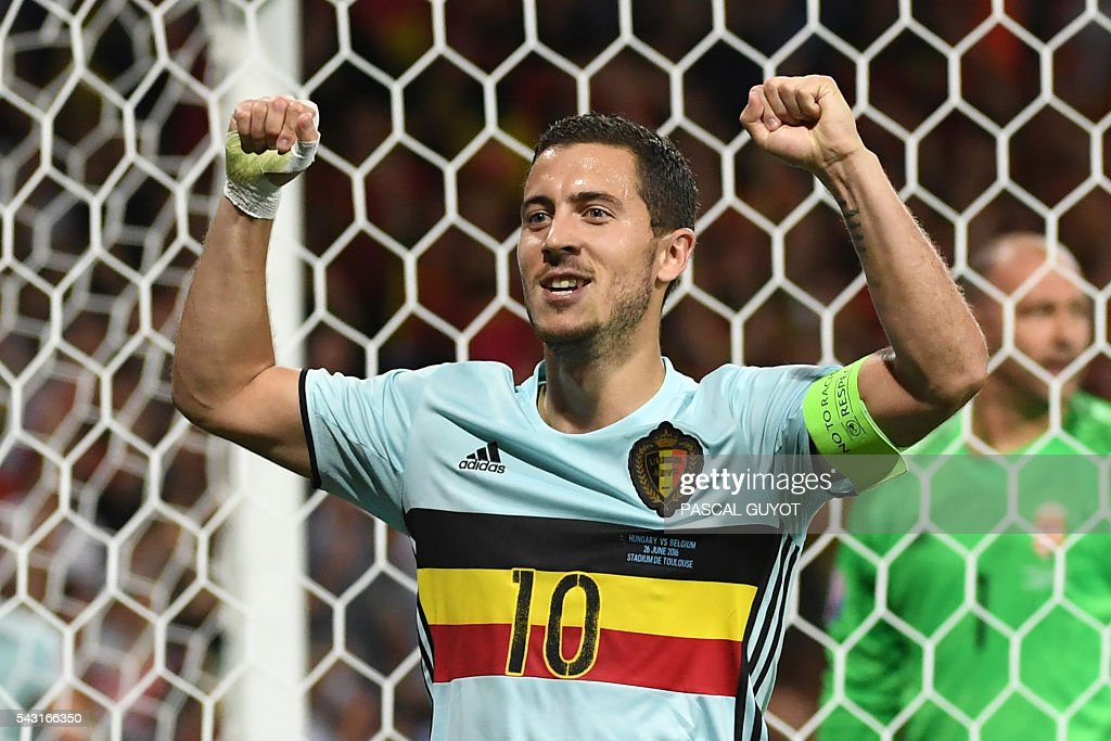 Belgium's forward Eden Hazard celebrates after scoring his team's third goal during the Euro 2016 round of 16 football match between Hungary and Belgium at the Stadium Municipal in Toulouse on June 26, 2016. / AFP / PASCAL