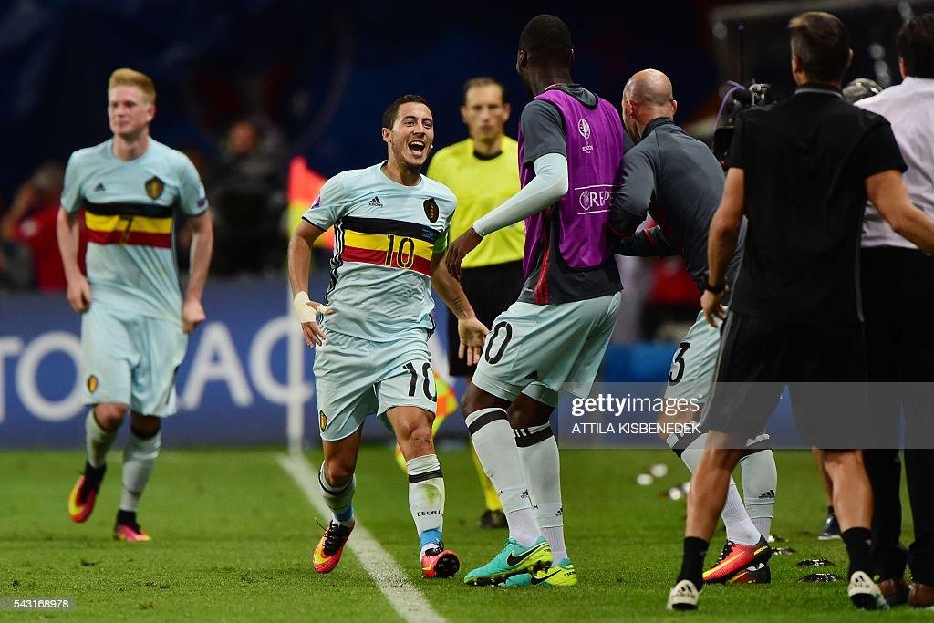 Belgium's forward Eden Hazard (C) celebrates after scoring his team's third goal during the Euro 2016 round of 16 football match between Hungary and Belgium at the Stadium Municipal in Toulouse on June 26, 2016. / AFP / Attila KISBENEDEK
