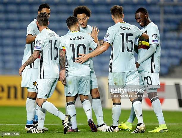 Belgium's forward Eden Hazard celebrates his goal with teammates during the WC 2018 football qualification match Gibraltar vs Belgium at the Faro...