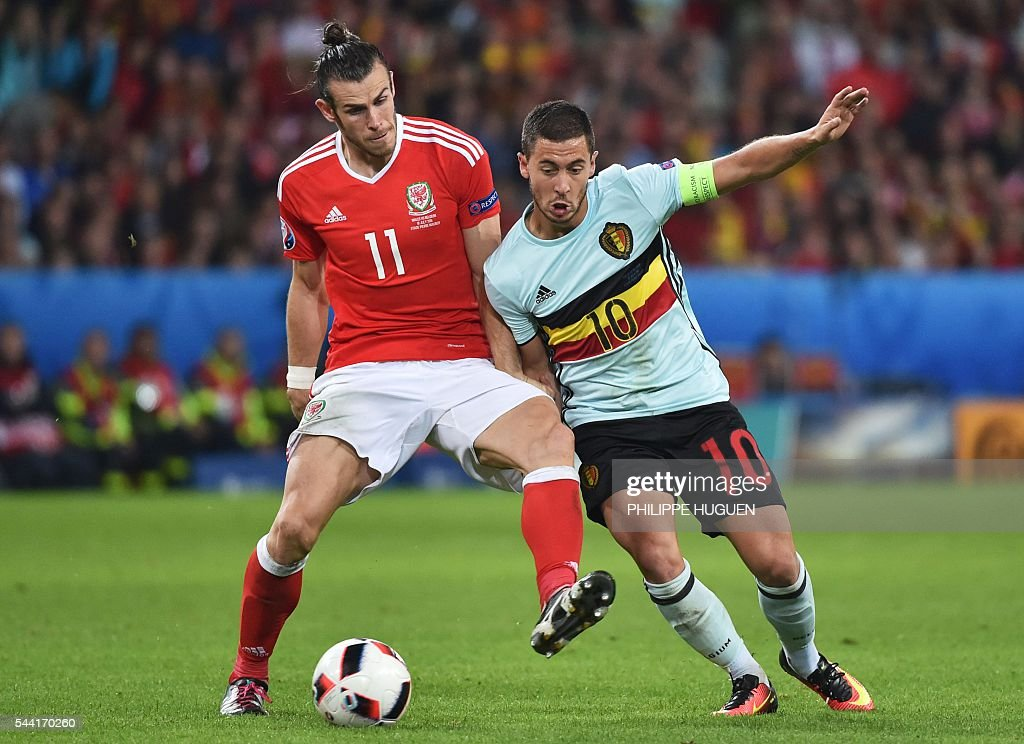 Belgium's forward Eden Hazard (R) challenges Wales' forward Gareth Bale during the Euro 2016 quarter-final football match between Wales and Belgium at the Pierre-Mauroy stadium in Villeneuve-d'Ascq near Lille, on July 1, 2016. / AFP / PHILIPPE