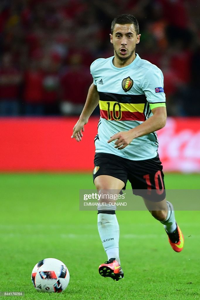 Belgium's forward Eden Hazard plays the ball during the Euro 2016 quarter-final football match between Wales and Belgium at the Pierre-Mauroy stadium in Villeneuve-d'Ascq near Lille, on July 1, 2016. / AFP / EMMANUEL