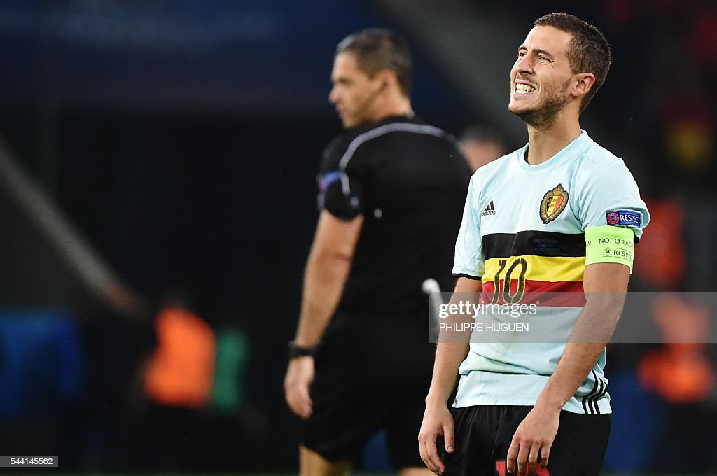 Belgium's forward Eden Hazard reacts after missing a goal opportunity during the Euro 2016 quarter-final football match between Wales and Belgium at the Pierre-Mauroy stadium in Villeneuve-d'Ascq near Lille, on July 1, 2016. / AFP / PHILIPPE