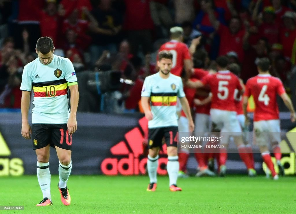 Belgium's forward Eden Hazard reacts after the Euro 2016 quarter-final football match between Wales and Belgium at the Pierre-Mauroy stadium in Villeneuve-d'Ascq near Lille, on July 1, 2016. Wales won the match 3-1. / AFP / EMMANUEL