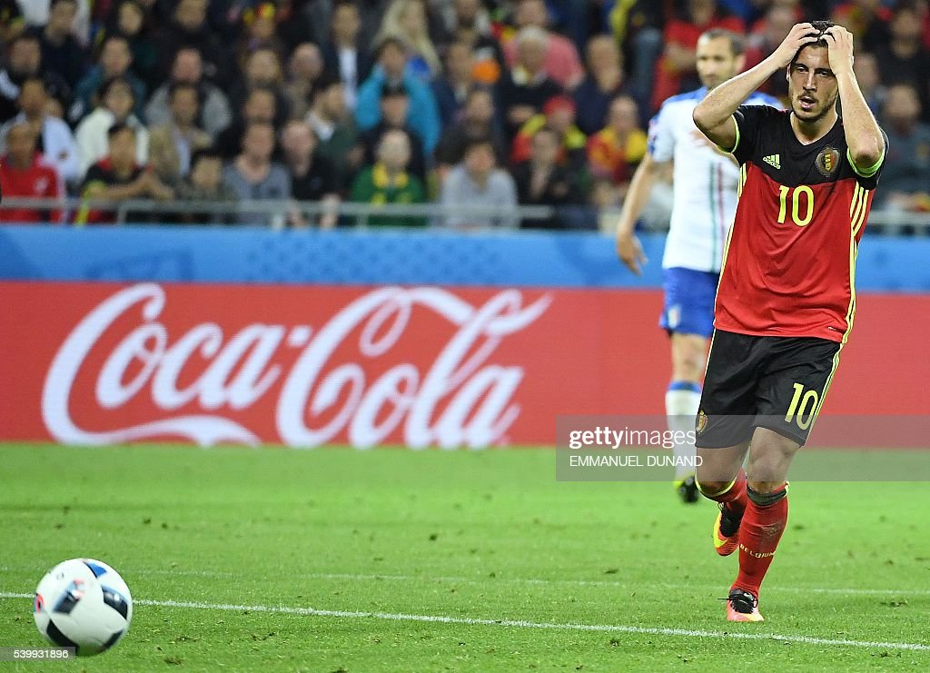 TOPSHOT - Belgium's forward Eden Hazard reacts during the Euro 2016 group E football match between Belgium and Italy at the Parc Olympique Lyonnais stadium in Lyon on June 13, 2016. Italy won 2-0. / AFP / EMMANUEL