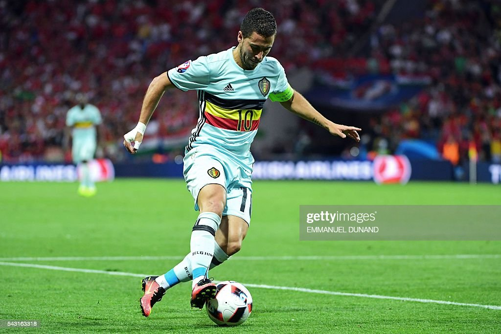 Belgium's forward Eden Hazard runs with the ball during the Euro 2016 round of 16 football match between Hungary and Belgium at the Stadium Municipal in Toulouse on June 26, 2016. / AFP / EMMANUEL