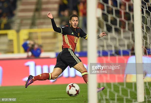 Belgium's forward Eden Hazard scores during the FIFA World Cup 2018 football qualification match between Belgium and Bosnia and Herzegovina at the...