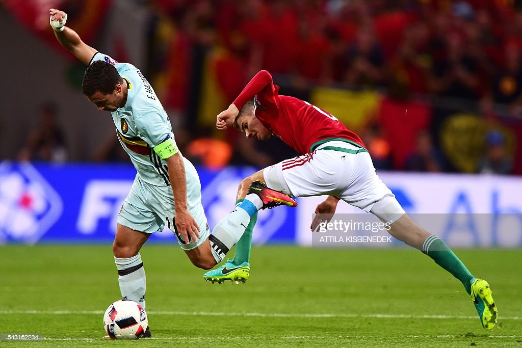 Belgium's forward Eden Hazard (L) vies for the ball with Hungary's midfielder Adam Nagy during the Euro 2016 round of 16 football match between Hungary and Belgium at the Stadium Municipal in Toulouse on June 26, 2016. / AFP / Attila KISBENEDEK