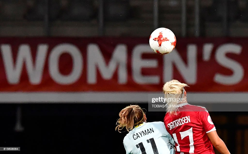 Belgium's forward Janice Cayman (L) fights for the ball with Denmark's midfielder Line Sigvardsen Jensen during the UEFA Women's Euro 2017 football tournament between Denmark and Belgium at Stadium De Vijverberg in Doetinchem on July 16, 2017. /