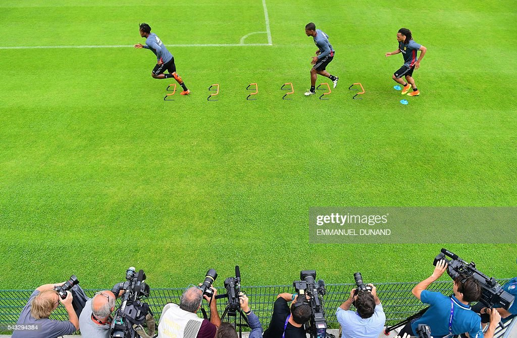 Belgium's forward Michy Batshuayi, Belgium's defender Christian Kabasele and Belgium's defender Jason Denayer take part in a training session in Le Haillan, southwestern France, on June 27, 2016, ahead of their Euro 2016 quarter-final football match against Wales. / AFP / EMMANUEL