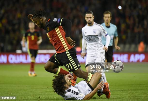 Belgium's forward Michy Batshuayi vies with Cyprus' Giorgos Vasiliou during the FIFA World Cup 2018 qualification football match between Belgium and...