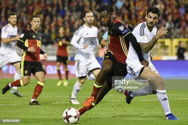 Belgium's forward Michy Batshuayi vies with Cyprus' midfielder Giorgos Merkis during the FIFA World Cup 2018 qualification football match between...