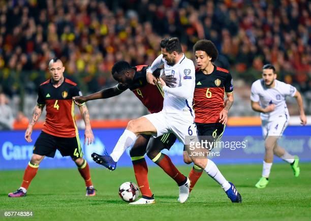 Belgium's forward Romelu Lukaku and Belgium's midfielder Axel Witsel vie with Greece's Alexandros Tziolis during the FIFA World Cup 2018...