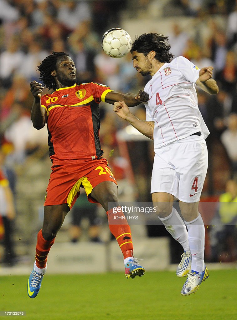 Belgium's forward <a gi-track='captionPersonalityLinkClicked' href=/galleries/search?phrase=Romelu+Lukaku&family=editorial&specificpeople=6342802 ng-click='$event.stopPropagation()'>Romelu Lukaku</a> (L) and Serbia's defender Milan Bisevac fight for the ball during the 2014 World Cup qualifying football match between Belgium and Serbia at the King Baudouin stadium in Brussels on June 7, 2013.