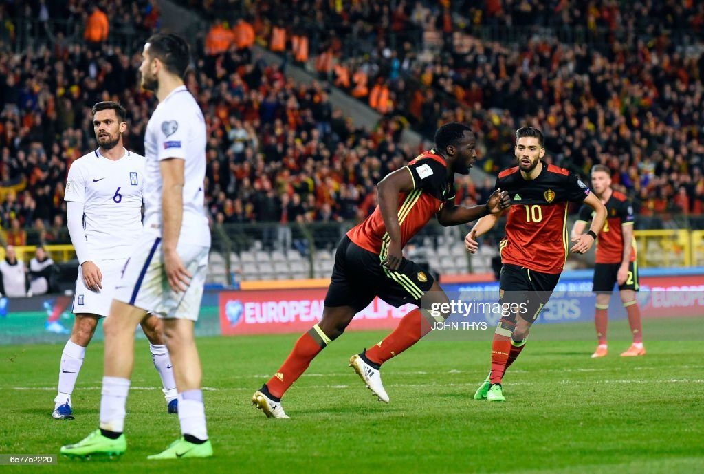 Belgium's forward Romelu Lukaku (L) celebrates after scoring during the FIFA World Cup 2018 qualification football match between Belgium and Greece, at the King Baudouin Stadium, on March 25, 2017 in Brussels. /