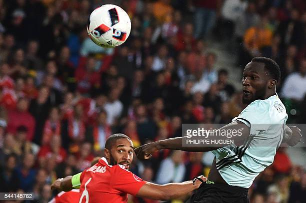 Belgium's forward Romelu Lukaku challenges Wales' defender Ashley Williams during the Euro 2016 quarterfinal football match between Wales and Belgium...