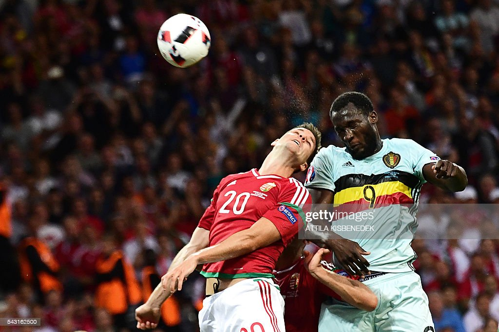 Belgium's forward Romelu Lukaku (R) jumps for the ball Hungary's defender Richard Guzmics during the Euro 2016 round of 16 football match between Hungary and Belgium at the Stadium Municipal in Toulouse on June 26, 2016. / AFP / ATTILA