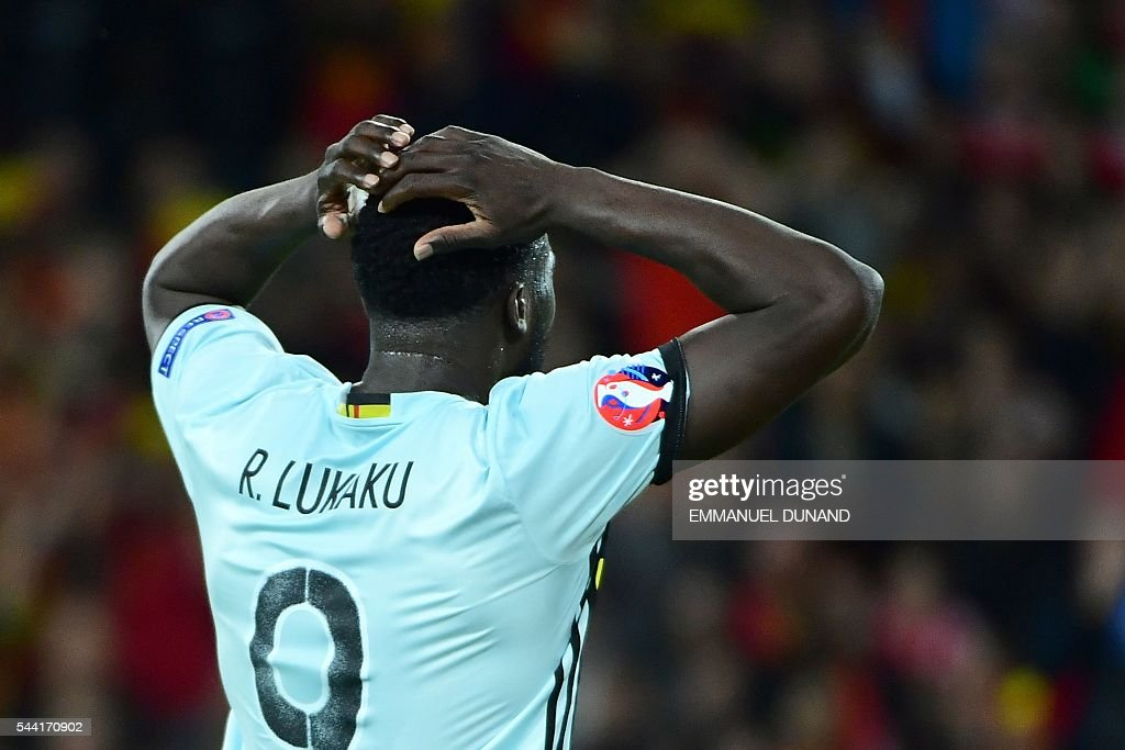 Belgium's forward Romelu Lukaku reacts during the Euro 2016 quarter-final football match between Wales and Belgium at the Pierre-Mauroy stadium in Villeneuve-d'Ascq near Lille, on July 1, 2016. / AFP / EMMANUEL