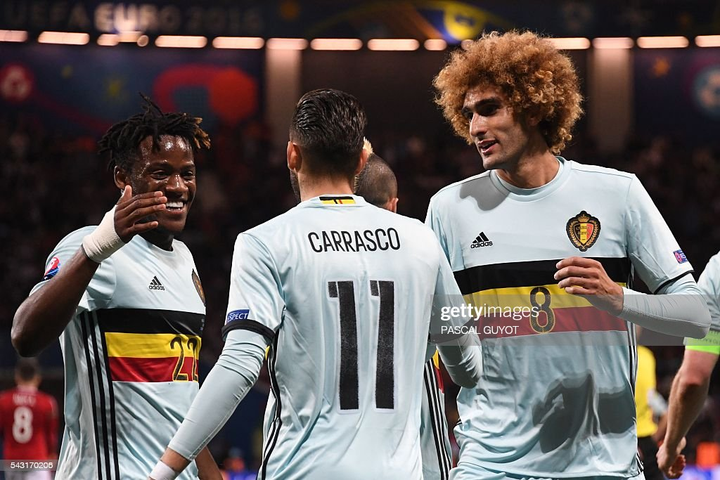 Belgium's forward Yannick Ferreira-Carrasco (C) celebrates with Belgium's forward Michy Batshuayi (L) and Belgium's midfielder Marouane Fellaini (R) after scoring his team's fourth goal during the Euro 2016 round of 16 football match between Hungary and Belgium at the Stadium Municipal in Toulouse on June 26, 2016. / AFP / PASCAL
