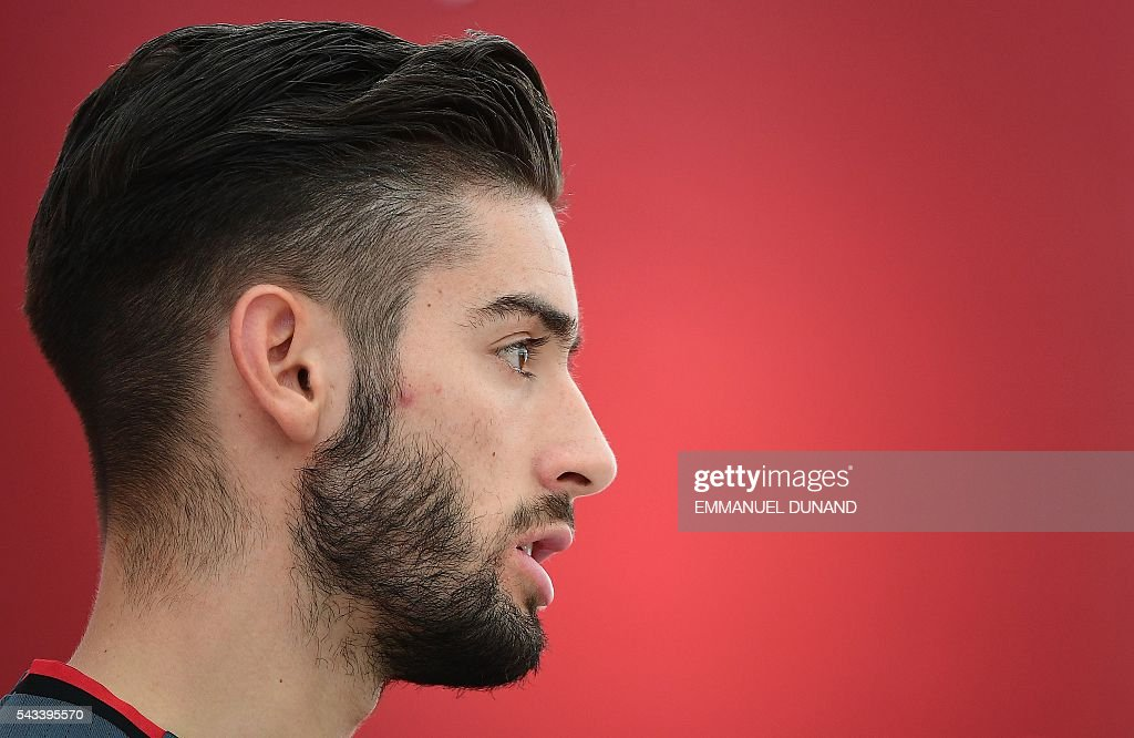 Belgium's forward Yannick Ferreira-Carrasco gives a press conference during the Euro 2016 football tournament at Le Haillan, France, on June 28, 2016. / AFP / EMMANUEL