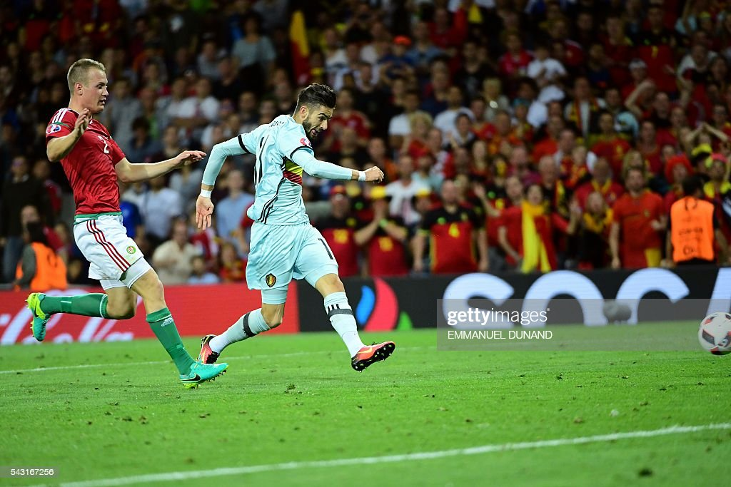 Belgium's forward Yannick Ferreira-Carrasco (R) shoots and scores his team's fourth goal during the Euro 2016 round of 16 football match between Hungary and Belgium at the Stadium Municipal in Toulouse on June 26, 2016. / AFP / EMMANUEL