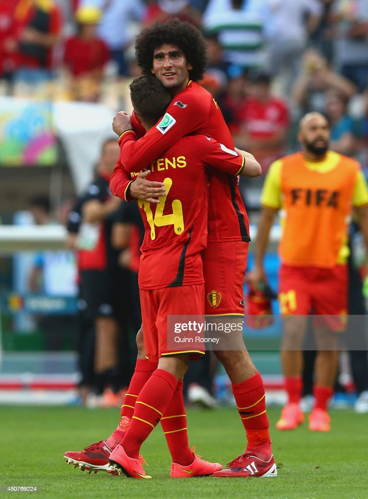 Belgium's goal scorers <a gi-track='captionPersonalityLinkClicked' href=/galleries/search?phrase=Dries+Mertens&family=editorial&specificpeople=6524919 ng-click='$event.stopPropagation()'>Dries Mertens</a> (L) and <a gi-track='captionPersonalityLinkClicked' href=/galleries/search?phrase=Marouane+Fellaini&family=editorial&specificpeople=3936316 ng-click='$event.stopPropagation()'>Marouane Fellaini</a> of Belgium celebrate after defeating Algeria 2-1 during the 2014 FIFA World Cup Brazil Group H match between Belgium and Algeria at Estadio Mineirao on June 17, 2014 in Belo Horizonte, Brazil.