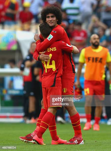 Belgium's goal scorers Dries Mertens and Marouane Fellaini of Belgium celebrate after defeating Algeria 21 during the 2014 FIFA World Cup Brazil...
