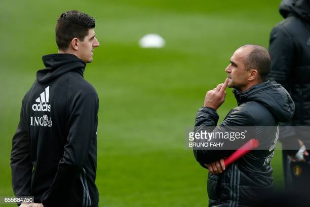 Belgium's goalkeeper Thibaut Courtois and Belgium's head coach Roberto Martinez talk during a training session of Belgian national soccer team Red...