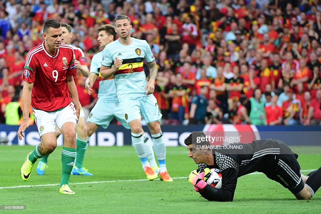 Belgium's goalkeeper Thibaut Courtois (R) catches the ball next to Hungary's forward Adam Szalai (L) during the Euro 2016 round of 16 football match between Hungary and Belgium at the Stadium Municipal in Toulouse on June 26, 2016. / AFP / EMMANUEL