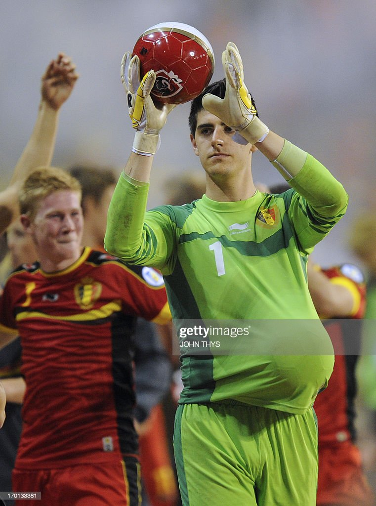 Belgium's goalkeeper Thibaut Courtois celebrates his team's victory at the end of the 2014 World Cup Qualifying football match between Belgium and Serbia at the King Baudouin stadium in Brussels on June 7, 2013.
