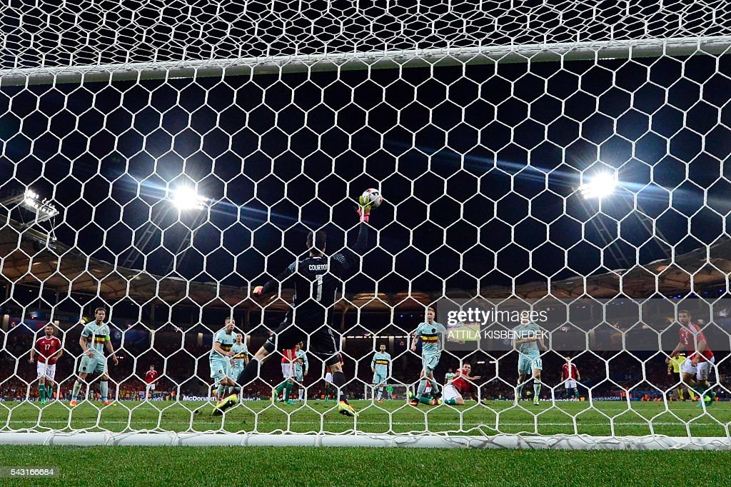Belgium's goalkeeper Thibaut Courtois (C) saves a shot during the Euro 2016 round of 16 football match between Hungary and Belgium at the Stadium Municipal in Toulouse on June 26, 2016. / AFP / ATTILA