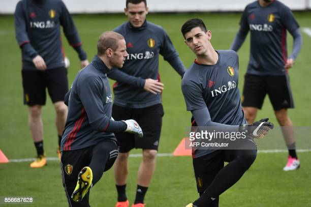 Belgium's goalkeepers Matz Sels and Thibaut Courtois attend a training session of the Belgian national football team on October 2 2017 in Tubize The...