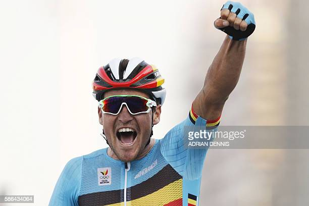 TOPSHOT Belgium's Greg Van Avermaet celebrates after winning the Men's Road cycling race in the Rio 2016 Olympic Games in Rio de Janeiro on August 6...