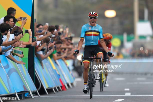 Belgium's Greg Van Avermaet celebrates after winning the Men's Road cycling race in the Rio 2016 Olympic Games in Rio de Janeiro on August 6 2016 /...