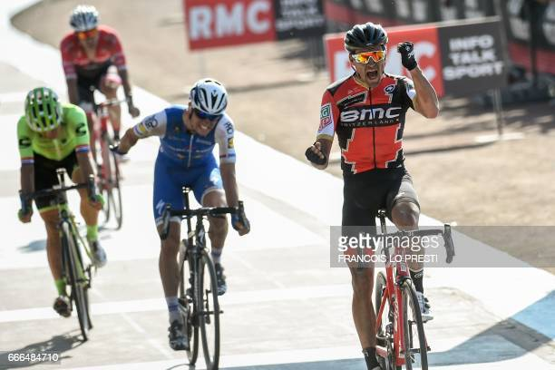 Belgium's Greg Van Avermaet celebrates as he crosses the finish line ahead of Czech Republic's Zdenek Stybar at the end of the 115th edition of the...