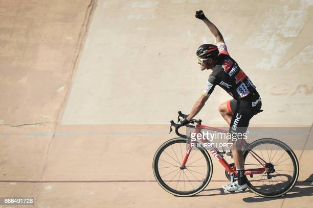 Belgium's Greg Van Avermaet celebrates as he crosses the finish line at the end of the 115th edition of the ParisRoubaix oneday classic cycling race...