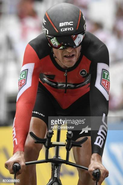Belgium's Greg Van Avermaet crosses the finish line at the Velodrome stadium at the end of a 225 km individual timetrial the twentieth stage of the...