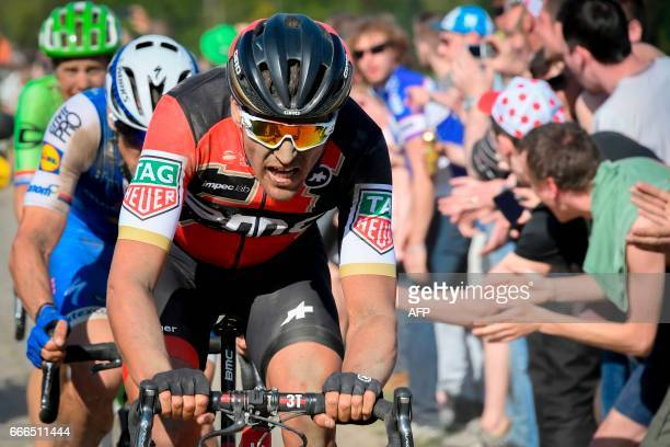 Belgium's Greg Van Avermaet Czech Republic's Zdenek Stybar and Netherlands' Sebastian Langeveld ride on the cobblestones in a breakaway during the...