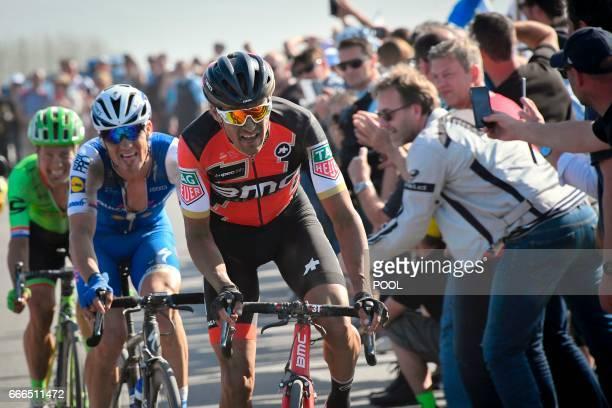 Belgium's Greg Van Avermaet Czech Republic's Zdenek Stybar and Netherlands' Sebastian Langeveld ride on the cobblestones in a breakaway during the...