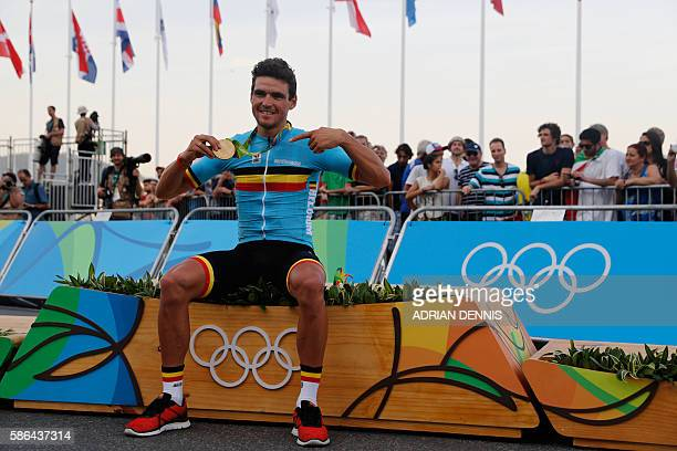 Belgium's Greg Van Avermaet poses with his gold medal after winning the Men's Road cycling race in the Rio 2016 Olympic Games in Rio de Janeiro on...