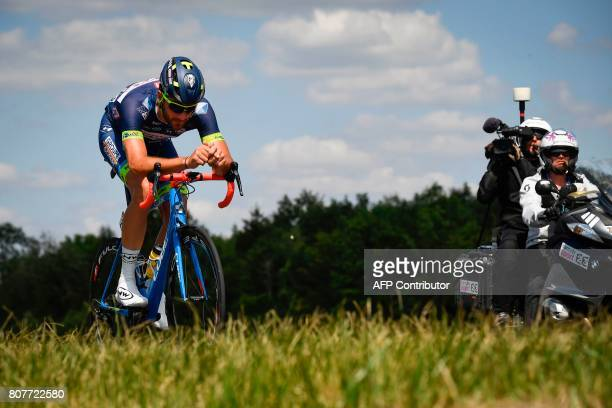 Belgium's Guillaume Van Keirsbulck rides in a breakaway as a cameraman films during the 2075 km fourth stage of the 104th edition of the Tour de...