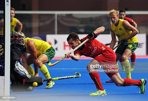 Belgium's hockey player Florent van Aubel scores a goal past Australian goalkeeper Tyler Lovell during their Hero Hockey Champions Trophy 2014 match...