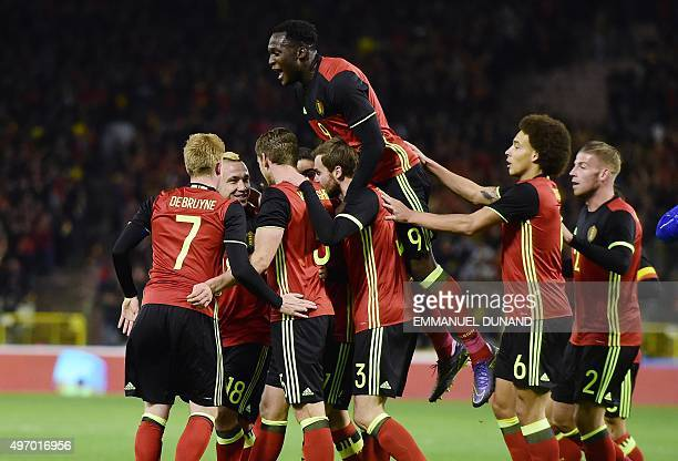 Belgium's Jan Vertonghen celebrates with teammates after scoring during the friendly international match between Belgium and Italy at Baudoin King...