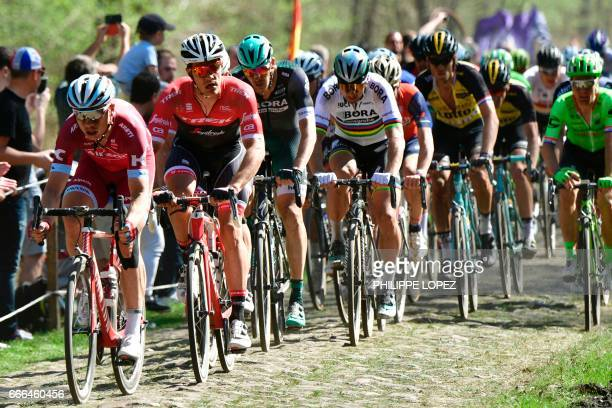 Belgium's Jasper Stuyven and Slovakia's Peter Sagan ride on the cobblestones during the 115th edition of the ParisRoubaix oneday classic cycling race...