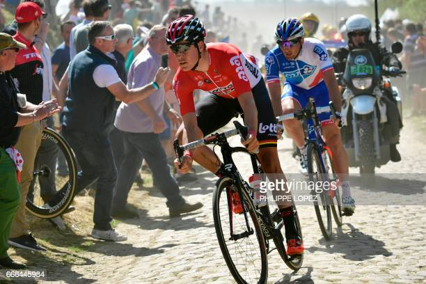 Belgium's Jelle Wallays and France's Mickael Delage ride on the cobblestones in a breakaway during the 115th edition of the ParisRoubaix oneday...