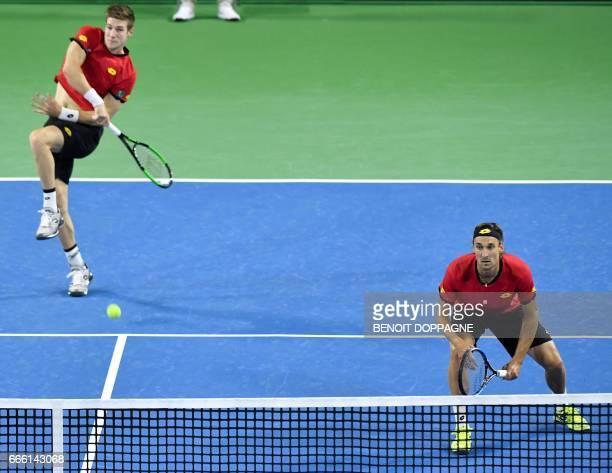 Belgium's Joris De Loore and Ruben Bemelmans during the Davis Cup World Group quarterfinal between Belgium and Italy on April 8 in Charleroi / AFP...