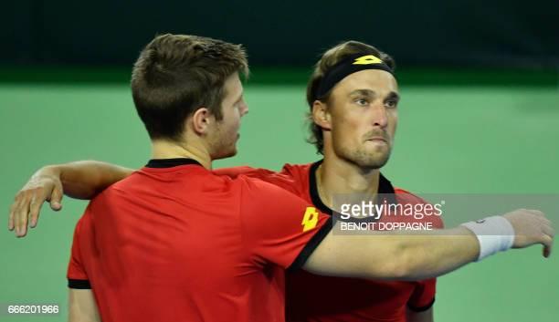 Belgium's Joris De Loore and Ruben Bemelmans react after loosing the third game of the Davis Cup World Group quarterfinal between Belgium and Italy...