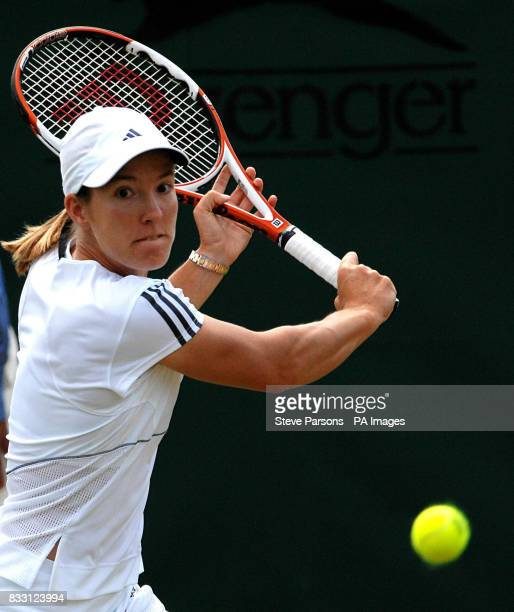 Belgium's Justine Henin in action against Russia's Elena Vesnina during The All England Lawn Tennis Championship at Wimbledon