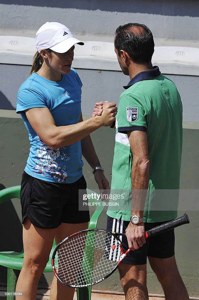 Belgium's Justine Henin listens to her coach Carlos Rodriguez during a training session ahead of the Roland Garros Grand Slam tennis tournament on...