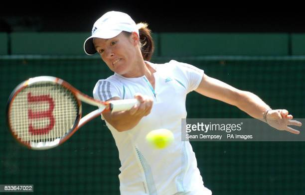 Belgium's Justine HeninHardenne in action against Slovakia's Daniela Hantuchova during the fourth round of The All England Lawn Tennis Championships...